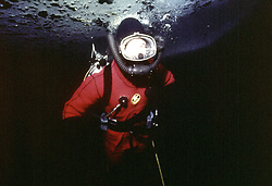 File photo dated 01/04/75 of the Prince of Wales diving under the arctic ice at Resolute Bay, Canada.