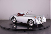 """The Junior Cars that reach speeds of 46mph and cost from £8000 up to £20,000<br /> <br /> <br /> Silver Roadster starting price £9,995<br /> http://www.youtube.com/watch?v=5GvgjxKY784&feature=youtu.be<br /> <br /> This could be the ultimate toys for rich brats – unless the brat was us, and then it would be absolutely fine.<br /> <br /> Think what you might about a toy car that costs about as much a nicely equipped Mini, these  Junior Cars are absolutely amazing.<br /> <br /> Styled to look like a 1960s classics customers are free to specify the color and trim, much like they would a real Aston. The headlights, indicators, and horn are all fully-functional too.<br /> <br /> The cabin has a wood-rimmed steering wheel, while the seats can be ordered in vinyl or leather trim. If you think that's insane, then take a look at the Junior cars performance specs!<br /> <br /> This isn't some pedal-powered contraption, not by a long shot. Under the tiny hood is a 110cc gasoline-fed engine which features key-operated starting, and comes mated to a 3-speed semi-automatic transmission. According to Nicholas Mee & Co., the London-based Aston Martin dealer offering the DB Junior, this wee toy car can hustle its way to a top speed of 46 mph.<br /> <br /> Yep, Junior could just about get his first taste for highway driving in this thing! The top speed can<br /> <br /> be adjusted downwards, however.<br /> <br /> There's good news for those who are young at heart – these cars has room for a full-size adult.<br /> <br /> """"We regularly have enquiries from our clients looking for something unusual and different to add to their collection of classics,"""" said dealership manager Benja Hedlet of Pocket Classics.co.uk<br /> <br /> Specifcations<br /> <br /> In standard tune the cars reach 45mph (72 kph). This can be restricted for younger drivers. Owners may modify the cars to reach speeds in excess of 80 mph (128 kph). The cars in standard tune use approx. 1.5 litres an hour.<br /> <br /> Len"""