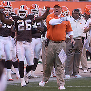 MORNING JOURNAL/DAVID RICHARD.Cleveland defensive coordinator Todd Grantham, center, encourages his squad after the Browns' defense held Miami on a fourth down play late in the fourth quarter to preserve the Cleveland shutout. Also celebrating is defensive back Sean Jones, left.