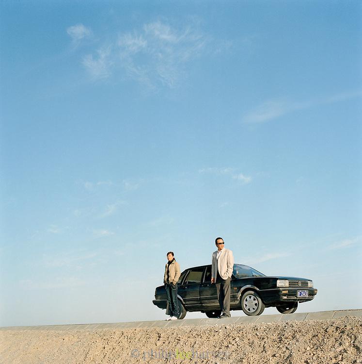 Tourists guides on road to Jiayuguan, Silk Route, Dunhuang, Jiuquan, Gansu Province, China.
