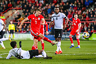 Wales midfielder Will Vaulks shoots towards the goal during the Friendly European Championship warm up match between Wales and Trinidad and Tobago at the Racecourse Ground, Wrexham, United Kingdom on 20 March 2019.