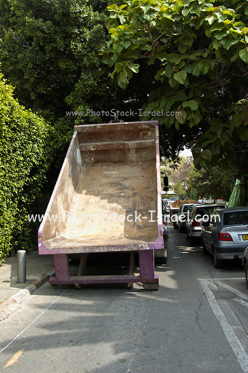 Truck unloading a container for building material waste