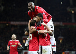 Manchester United's Marcus Rashford (right) celebrates scoring his side's second goal with his team-mates during the UEFA Champions League match at Old Trafford, Manchester.