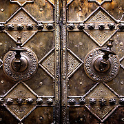 Bronze door handles on one of the 14 doors of the Kairaouine Mosque in the medina in Fez. The mosque was built in the 9th century AD and is considered the most important in Morocco.