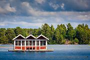 Floating little shacks on dock in Gota Canal in the city of Trollhattan, Sweden