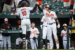 July 19, 2017 - Baltimore, MD, USA - The Baltimore Orioles' Adam Jones (10) celebrates with teammate Manny Machado (13) after hitting a solo home run against the Texas Rangers in the first inning at Oriole Park at Camden Yards in Baltimore on Wednesday, July 19, 2017. The Orioles won, 10-2. (Credit Image: © Michael Ares/TNS via ZUMA Wire)