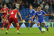 Cardiff City's Frederic Gounongbe (r) shoots at goal while being challenged by Blackburn's Jason Lowe.  EFL Skybet championship match, Cardiff city v Blackburn Rovers at the Cardiff city stadium in Cardiff, South Wales on Wednesday 17th August 2016.<br /> pic by Carl Robertson, Andrew Orchard sports photography.