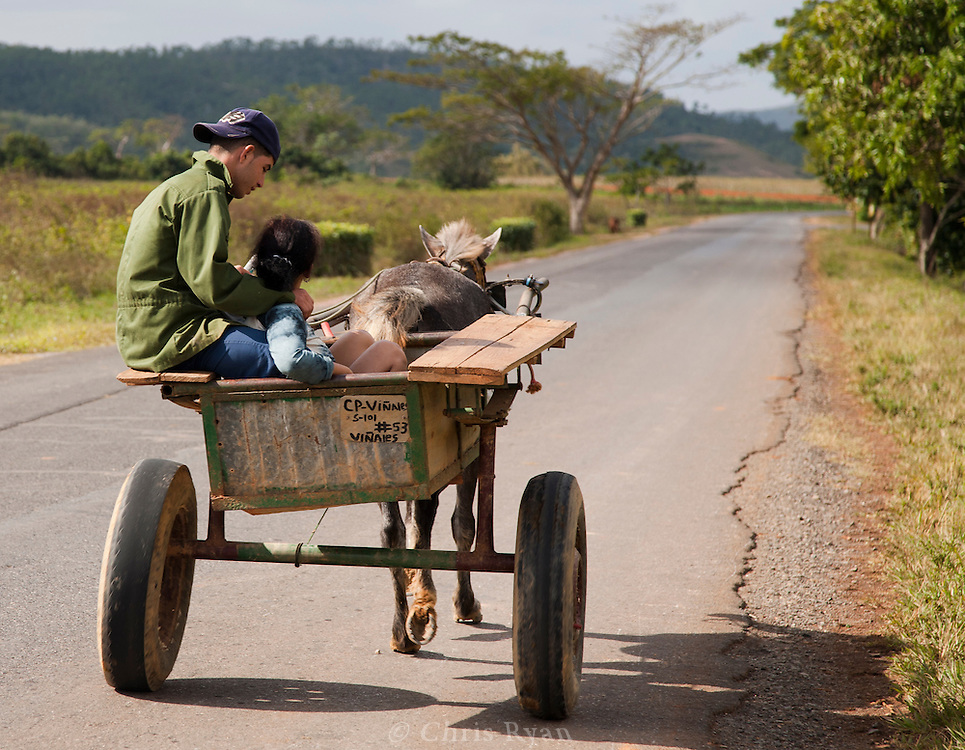 Young couple driving horse and cart, Vinales Valley, Cuba