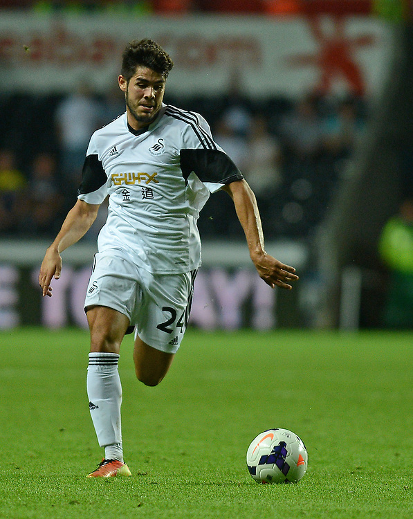 Swansea City's Alejandro Pozuelo in action during todays match  <br /> <br /> (Photo by Ian Cook/CameraSport)<br /> <br /> Football - UEFA Europa League Qualifying Play-off First leg - Swansea City v Petrolul Ploiesti - Thursday 22nd August 2013 - The Liberty Stadium - Swansea<br /> <br /> © CameraSport - 43 Linden Ave. Countesthorpe. Leicester. England. LE8 5PG - Tel: +44 (0) 116 277 4147 - admin@camerasport.com - www.camerasport.com