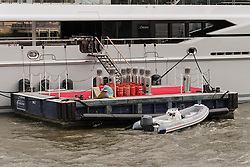 © Licensed to London News Pictures. 29/03/2018. London, UK. Gas cannisters and heaters next to the 220ft custom luxury superyacht, 'Global' moored at Butlers Wharf near Tower Bridge during a London visit. Previously named, Kismet during her last central London visit, she underwent a refit which saw her moved up 51 places in Boat International's list of top 200 largest super yachts in the world, boasting numerous luxuries such as a helipad, cinema and jacuzzi. Believed to be owned by Fulham Football Club chairman, Shahid Khan, Global can be chartered for an estimated £1m per week. Powered by 2 Caterpillar (3512 B) 2,038hp diesel engines and propelled by her twin screws propellers, Global is capable of a top speed of 15.5 knots, and comfortably cruises at 14 knots. . Photo credit: Vickie Flores/LNP