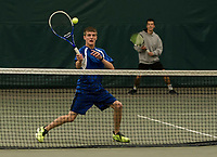 Connor Craigie returns a shot during doubles match with his partner Grant Workman against Kearsarge Tyler and Tucker Valovic during NHIAA semi final Division III tennis at Gilford Hills Club on Friday afternoon.  (Karen Bobotas/for the Laconia Daily Sun)