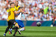Tranmere Rovers midfielder James Norwood (10) shields the ball from Newport County defender Mickey Demetriou (28) during the EFL Sky Bet League 2 Play Off Final match between Newport County and Tranmere Rovers at Wembley Stadium, London, England on 25 May 2019.