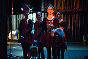 Students of Nevada Dance Academy wait in the wings before performing as mice during the Bay Pointe Ballet production of the Nutcracker at the Grand Sierra Resort and Casino in Reno, Nevada, on December 8, 2013. (Stan Olszewski/SOSKIphoto)