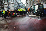 The protest group Extinction Rebellion stage a protest of fake blood in front of Downing Street ten, 9th March 2019, Central London, United Kingdom. Whitehall was closed for traffic while the group staged their The Blood of Our Children action where they poured hundreds of litres of fake blood across the road. After the blood was spilt a number of speakers, including children spoke of their fears of the future where man made climate change could have a devastating effect on the planet and human life. The group Extinction Rebellion is a movement which wants to force the Government to introduce radical climate change policies using civil disobedience and mass arrests.