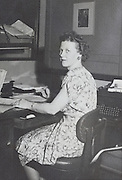 female secretary office worker at her desk portrait USA 1945