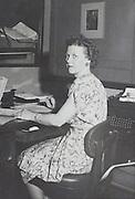 female secretary office worker at her desk portrait USA 1945