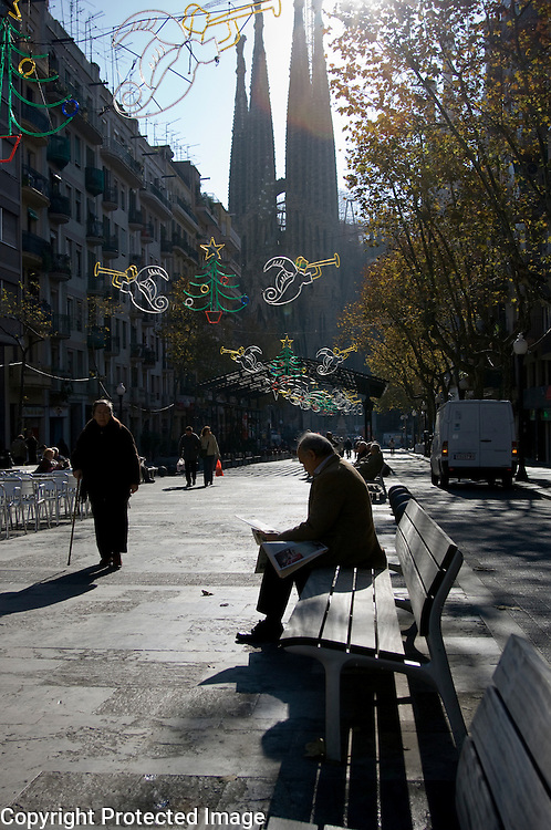 Relaxing in the sun with on the background the Sagrada Familia Barcelona