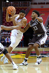 22 November 2017:  William Tinsley splits defenders Demetrius Houston and De'Andre Alexander during a College mens basketball game between the Quincy Hawks and Illinois State Redbirds in  Redbird Arena, Normal IL