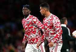 Manchester United's Paul Pogba and Cristiano Ronaldo (right) warm up before the UEFA Champions League, Group F match at Old Trafford, Manchester. Picture date: Wednesday September 29, 2021.