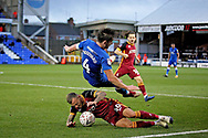 Peterborough United midfielder Alex Woodyard (4) is upended by Bradford City forward David Ball (40)  during  the The FA Cup 2nd round match between Peterborough United and Bradford City at London Road, Peterborough, England on 1 December 2018.