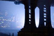 downtown Manhattan and Brooklyn bridge seen from under the Manhattan bridge
