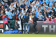 Manchester city manager Manuel Pellegrini gives his jacket away to a delighted Manchester city fan after the game finishes, his last in charge. Barclays Premier league match, Swansea city v Manchester city at the Liberty Stadium in Swansea, South Wales on Sunday 15th May 2016.<br /> pic by Andrew Orchard, Andrew Orchard sports photography.