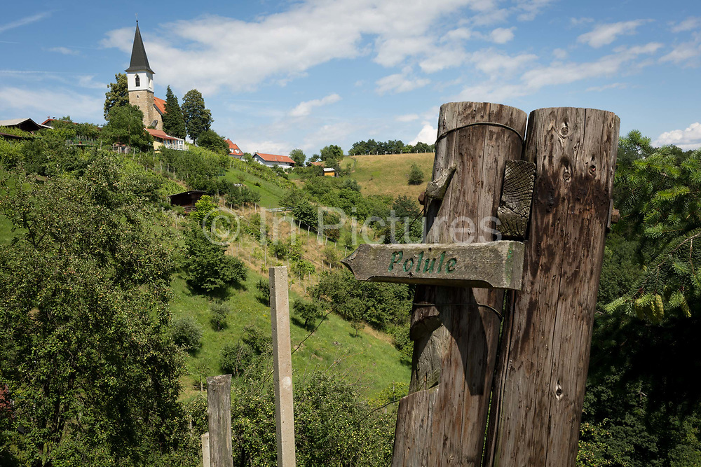 A walking marker points to a local place near Saint Michaels church, on 23rd June 2018, in Celje, Slovenia.