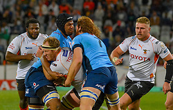 Carl Wegner of the Free State Cheetahs tackled by Marvin Orie and Jannes Kirsten of the Blue Bulls during the Currie Cup 1st division match between the The Free State Cheetahs and the Blue Bulls held at Toyota Stadium (Free State Stadium), Bloemfontein, South Africa on the 13th August 2016<br /> <br /> Photo by:   Frikkie Kapp / Real Time Images