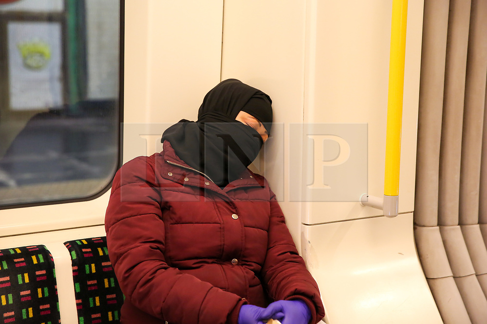 © Licensed to London News Pictures. 11/03/2020. London, UK. A commuter wearing a surgical face mask travels on the London Underground train amid an increased number of cases of Coronavirus (COVID-19) in the UK. 456 cases have tested positive for the virus in the UK. Photo credit: Dinendra Haria/LNP