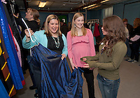 Founders Laura Brusseau and Jessica Dutile help Stormy Leroux of Laconia in selecting one of the hundreds of prom dresses donated for the Faith, Hope and Love Foundation's 5th annual Gowns for Girls event Saturday morning at the Franklin Community Center.  (Karen Bobotas/for the Laconia Daily Sun)