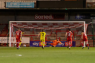 GOAL 1-0 Crawley Town goalkeeper Glenn Morris (#1) is sent the wrong way from the spot the EFL Sky Bet League 2 match between Crawley Town and Walsall at The People's Pension Stadium, Crawley, England on 16 March 2021.