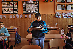 "Kevin Kocko, 12, a relative of Helena Kocková, reads in class at the predominantly Roma elementary school Zakladni Skola in their neighborhood of Vitkovice in Ostrava, Czech Republic on March 5, 2012. Helena Kocková is one of 18 Roma children who were represented in the D.H. and Others v. Czech Republic case, the first challenge to systemic racial segregation in education to reach the European Court of Human Rights. When this case was first brought in 2000, Roma children in the Czech Republic were 27 times more likely to be placed in ""special schools,"" intended for the mentally disabled, than non-Roma children. In 2007, the Grand Chamber of the European Court of Human Rights ruled that this pattern of segregation violated nondiscrimination protections in the European Convention on Human Rights. Despite this landmark decision, little change has occurred: the ""special schools"" have been renamed but follow the same substandard curriculum and Roma continue to be assigned to these schools in disproportionate numbers. The process of integration has barely begun."