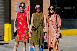 Street style, Irene Kim, Chriselle Lim and Aimee Song arriving at 3.1 Phillip Lim Spring Summer 2017 show held at Skylight Clarkson North, 572 Washington Street, in New York, USA, on September 12, 2016. Photo by Marie-Paola Bertrand-Hillion/ABACAPRESS.COM / RealTime Images