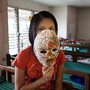 """Shanon, 16. (Not her real name). She is happy to be in the Laura Vicuna home for the protection it gives and for the hope it has brought back to her. She loves reading and to dance, listening to music and play the guitar. She has choreographed many of the dance performances the girls do in the home to great applause by the audience. She wants to be a Video Jockey(VJ) to help the other children in the home. She wants to work in TV as a place to highlight the issues and lives the children go through...""""The curly gold on the left side of the mask signifies all the positive things which have happened in my life. The mixed colours all the confusion and problems, which are happening in my life which at the moment are overpowering my life. I hope some day it will be different, that it will be the other way around."""