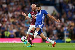 Diego Costa of Chelsea is challenged by James Collins of West Ham United - Rogan Thomson/JMP - 15/08/2016 - FOOTBALL - Stamford Bridge Stadium - London, England - Chelsea v West Ham United - Premier League Opening Weekend.