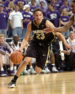 Colorado guard Richard Roby (C) drives to the basket against Kansas State's Akeem Wright (R) during the first half of the Wildcats 72-60 win over the Buffaloes at Bramalage Coliseum in Manhattan, Kansas, February 18, 2006.