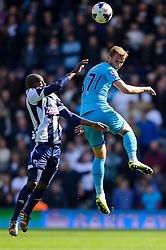 Youssuf Mulumbu (COD) of West Brom and Harry Kane (ENG) of Tottenham Hotspur compete in the air - Photo mandatory by-line: Rogan Thomson/JMP - 07966 386802 - 12/04/2014 - SPORT - FOOTBALL - The Hawthorns Stadium - West Bromwich Albion v Tottenham Hotspur - Barclays Premier League.