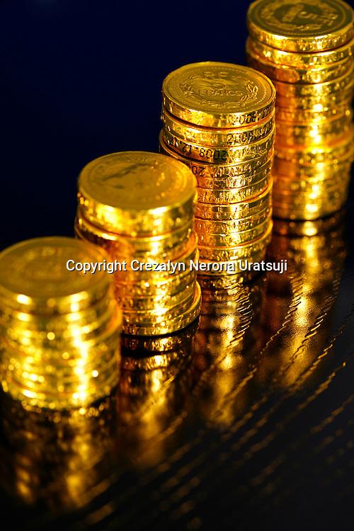 Success growth chart made of golden coins (golden chocolate coins)