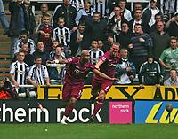 Photo: Andrew Unwin.<br /> Newcastle United v Bolton Wanderers. The Barclays Premiership. 15/10/2006.<br /> Bolton's El-Hadji Diouf (L) celebrates his second goal.