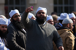"""London, February 8th 2015. Muslims demonstrate outside Downing Street  """"to denounce the uncivilised expressionists reprinting of the cartoon image of the Holy Prophet Muhammad"""". PICTURED: Muslims trade insults with right wing counter-protesters from the English Defence League and Britain First."""