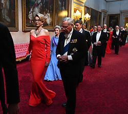 Ms Emma Walmsley and the Duke of Gloucester arrive through the East Gallery during the State Banquet at Buckingham Palace, London, on day one of the US President's three day state visit to the UK.