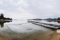 The ice is slowing receding around Saunders Bay looking out over Lake Winnipesaukee Tuesday morning.   (Karen Bobotas/for the Laconia Daily Sun)