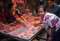 MAE KLONG - TAHILAND - CIRCA SEPTEMBER 2014: Local people buying at the Maeklong Railway Market