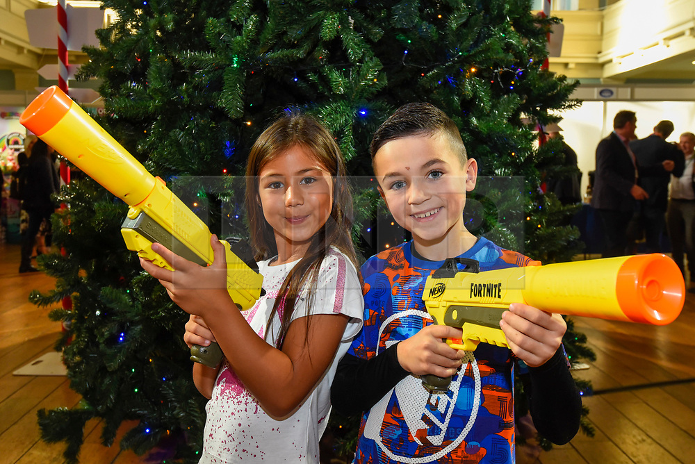 """© Licensed to London News Pictures. 13/11/2019. LONDON, UK. Ayva (aged 7) and Joshua (aged 8) play with Nerf Elite Fortnite SP-L Nerf guns by Hasbro at the preview of """"DreamToys"""", the official toys and games Christmas Preview, held at St Mary's Church in Marylebone.  Recognised as the countdown to Christmas, the Toy Retailer's Association, an independent panel of leading UK toy retailers, have selected the definitive and most authoritative list of which toys will be the hottest property this Christmas.  Photo credit: Stephen Chung/LNP"""
