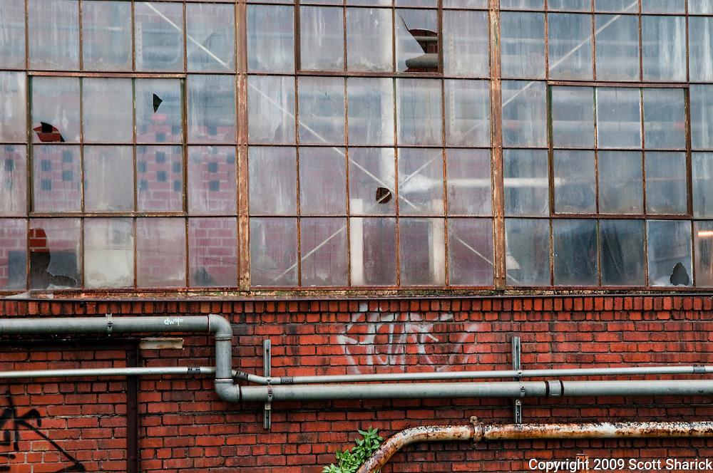 A brick warehouse sits vacant with broken windows. Missoula Photographer