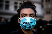 OAKLAND, CA - MAY 29: A demonstrator wears a protective face mask during protests against the death of George Floyd in police custody, in Oakland, California on May 29, 2020. (AP Photo/Philip Pacheco)