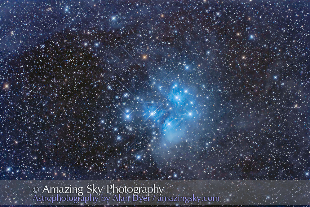 The Pleiades star cluster, Messier 45, amid the faint and dusty nebulosity that surrounds it. The stars of the Pleiades are passing through the dust clouds in Taurus and are lighting them up as examples of reflection nebulas. <br /> <br /> This is a stack of 8 x 8-minute exposures at ISO 400 with the Canon EOS Ra on the SharpStar HNT150 Hyperbolic Newtonian astrograph at f/2.8. Flat-fielded in PixInsight using T-shirt flats, and developed in Photoshop. Taken from home January 27, 2020.