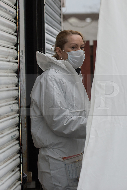 © Licensed to London News Pictures. 25/03/2016. <br /> Pictured: A Police Scotland Crime Scene Investigator at Delicious Deli, Clydebank. <br /> <br /> Police Scotland have focused the centre of the murder investigation of 15 year old Paige Doherty in Clydebank, Glasgow around the home and business premises of suspect John Leathem as they search his house and Delicious Deli near Fleming Street, Clydebank Glasgow on Friday 25th March 2016.<br /> <br />  Photo credit should read Max Bryan/LNP