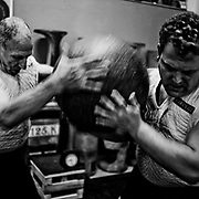 Joseba Astolaza and his father Agustin, stone lifters or harrijasotzaile in Basque language. Training in Orio. Basque rural sports (Herri Kirolak in basque language) are rooted in traditional lifestyles, mostly farmer occupations of the Basque Country, in Northern Spain. Nowadays they have transform themselves into sports based in strenght and skill. Stone lifting and wood chopping are the most popular.