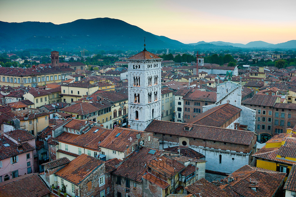 Campanile bell tower of the Church of San Michele and Lucca rooftops from Torre del Ore in Lucca,  Italy.. RESERVED USE - NOT FOR DOWNLOAD - FOR USE CONTACT TIM GRAHAM